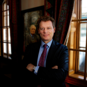 2018-04-06-Kevin Ralph - Jonathan Neame, Chief Executive of Shepherd Neame. With a portrait of his father in the background.